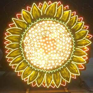 sunflower chasing lights sunflower light bulbs flower flowers florist storefront carnival