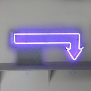 Purple arrow with 90* turn near head mounted to clear green plexi
