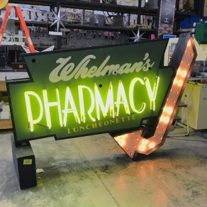 Whelman's Pharmacy - Double-Sided Vintage Sign Can with Yellow Neon and channel lightbulbs arrow